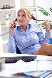 Beautiful and very sexy secretary working in office Stock Image