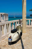 Beautiful Vespa scooter in a southern Italian beach Royalty Free Stock Photo