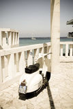 Beautiful Vespa scooter in a southern Italian beach filter with Stock Images