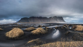 Beautiful Vesturhorn Mountain and black sand dunes in Iceland. stock image