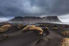 Beautiful Vesturhorn Mountain and black sand dunes in Iceland. Royalty Free Stock Photography