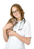 Beautiful veterinarian with puppy sharpei dog. looking at camera Royalty Free Stock Images