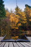 Beautiful vibrant Autumn woodland reflecions in calm lake waters Royalty Free Stock Photos