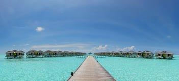Beautiful panoramic photo of over water bungalows at Maldives. Beautiful vibrant panoramic photo of over water bungalows located at Maldives royalty free stock image