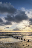 Beautiful vibrant seascape at sunset image with dramatic sky and Royalty Free Stock Photography