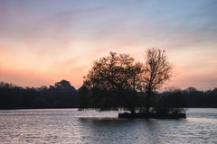 Beautiful vibrant Spring sunrise over calm lake in English count Stock Photography