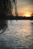 Beautiful vibrant Spring sunrise over calm lake in English count Stock Image