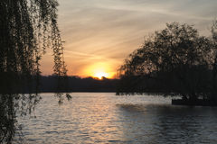 Beautiful vibrant Spring sunrise over calm lake in English count Royalty Free Stock Images