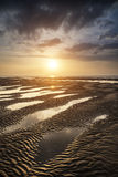 Beautiful vibrant Summer sunset over golden beach landscape Royalty Free Stock Image
