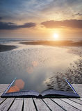 Beautiful vibrant Summer sunset over golden beach landscape with Stock Photo