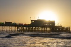 Beautiful vibrant sunrise landscape image of Worthing pier in West Sussex during Winter. Beautiful sunrise landscape image of Worthing pier in West Sussex during stock photo
