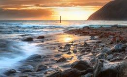 Beautiful vibrant sunrise over beach Stock Images