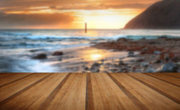 Beautiful vibrant sunrise over low tide beach landscape with woo Royalty Free Stock Photo