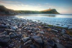Beautiful vibrant sunrise over rocky beach Royalty Free Stock Photography