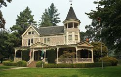 Beautiful Victorian Home. With greenery around it Stock Photography