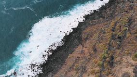 Beautiful video from the drone - turquoise water and waves on the coast of Tenerife, the Atlantic Ocean. 2k stock video footage