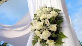 Beautiful video 4k of the Jewish Hupa.Closeup on a bouquet from roses. Beautiful video 4k of the Jewish Hupa with conducting of the camera from top to down stock video footage