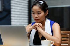 Beautiful vietnam female student using laptop pc outdoor Royalty Free Stock Image