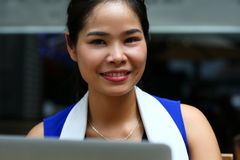 Beautiful vietnam smiling female student using notebook Royalty Free Stock Photography