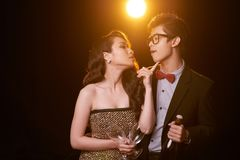 Celebrating annniversary. Beautiful Vietnamese boyfriend and girlfriend in love holding champagne and looking at each other Royalty Free Stock Image