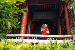 Beautiful Vietnamese woman in front of Buddhist temple Royalty Free Stock Photography