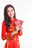 Beautiful Vietnamese woman with red ao dai holding red packet Royalty Free Stock Photos