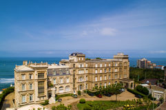 Beautiful view. Town, ocean coast, blue sky Stock Image