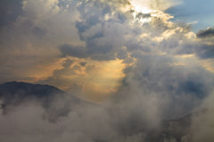 Beautiful view above cloudscape. And mountains Stock Images
