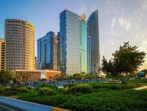 Beautiful view of Abu Dhabi city towers, buildings and parks at sunset from the corniche.  royalty free stock photos