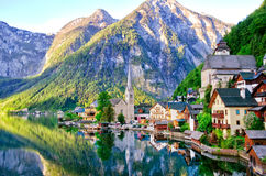 Beautiful view of Alpine Hallstatt town and Hallstattersee lake. Salzkammergut, Austria. Early morning sunrise in Hallstatt village royalty free stock image