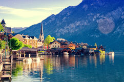 Beautiful view of Alpine Hallstatt town and Hallstattersee lake. Salzkammergut, Austria. Early morning sunrise in Hallstatt village. Filtered stock photography