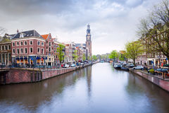 Beautiful view of Amstel river and houses facades Royalty Free Stock Images
