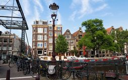 Beautiful view of Amsterdam canal with bridge and typical dutch houses. Holland royalty free stock photography