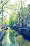 Beautiful view of Amsterdam canals with bridge and typical dutch Royalty Free Stock Images