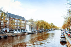 Beautiful view of Amsterdam canals with bridge and typical dutch Royalty Free Stock Photos