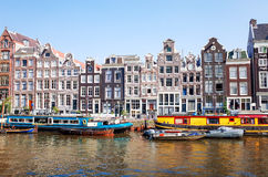 Beautiful view of Amsterdam canals with bridge and typical dutch Royalty Free Stock Image