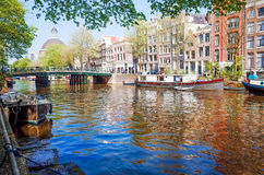 Beautiful view of Amsterdam canals with bridge and typical dutch Stock Photo