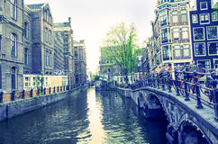 Beautiful view of Amsterdam canals with bridge and typical dutch Stock Images