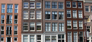 Beautiful view of Amsterdam houses Stock Photos