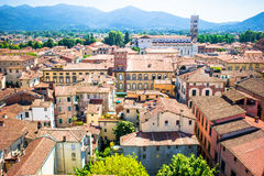 Beautiful view of ancient building with red roofs in Lucca, Italy Stock Photography