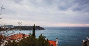 Beautiful view of the ancient city, the island and the sea on which the ship sails. Rovinj, Istria, Croatia royalty free stock photo