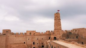 View of ancient Ribat of Monastir fortress with tower and flag of Tunisia. Beautiful view of ancient Ribat of Monastir fortress with tower and flag of Tunisia at stock footage