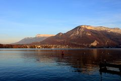 Beautiful view of the Annecy Lake in French Alps in sunset Royalty Free Stock Image