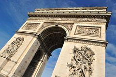 Beautiful  view of the Arc de Triomphe, Paris. Unusual view of the Arc of Triomphe in Paris with blue sky in background Royalty Free Stock Photo
