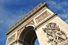 Beautiful  view of the Arc de Triomphe, Paris. Unusual view of the Arc of Triomphe in Paris with blue sky in background Stock Photography