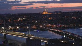Beautiful view of Ataturk Bridge and Golden Horn Bridge in the evening, a beautifully illuminated city, time lapse