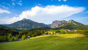 A beautiful view of the austrian alps with typical mountain hous Royalty Free Stock Photos