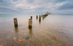Beautiful view on Baltic sandy coast with old military buildings Royalty Free Stock Photo