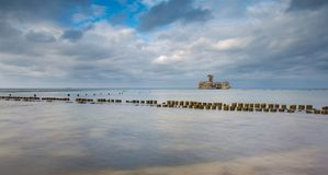 Beautiful view on Baltic sandy coast with old military buildings from world war II and wooden breakwaters. Stock Photos
