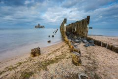 Beautiful view on Baltic sandy coast with old military buildings from world war II and wooden breakwaters. Stock Image
